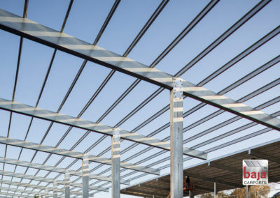 Baja Carport Full Cantilever T - Bolt-up Pre-Fabricated Engineered Connection Design with Purlins in-Place Ready for Solar Panels Installation.