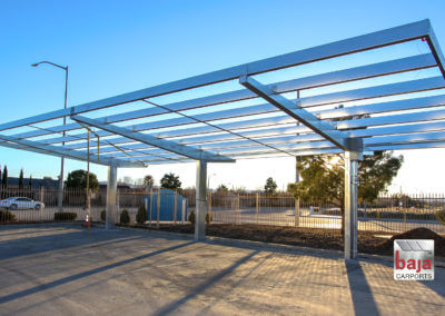 Baja Carport Full Cantilever Tapered Pre-Fabricated, Pre-Galvanized Steel Mainframe. Purlins Are In-Place and Ready for Rooftop Solar Panels.