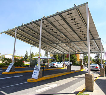 car wash business utilizes solar panels on carport frame to power the car wash