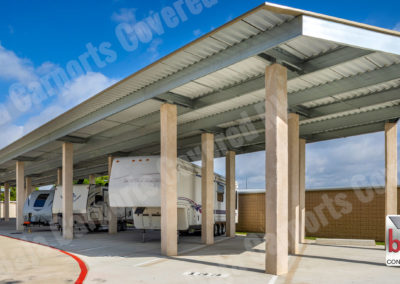 Covered RV & Boat Storage in Texas shows carport columns wrapped