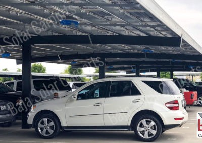 Solar carports cover Texas auto dealership protect from hail