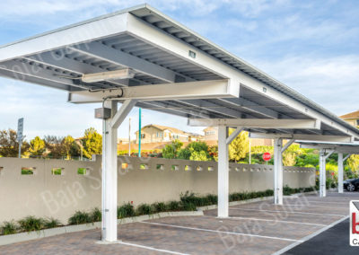 Solar panels on roof deck carport system on multifamily property