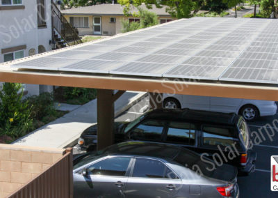 Roof deck with solar panels on apartment complexes carports