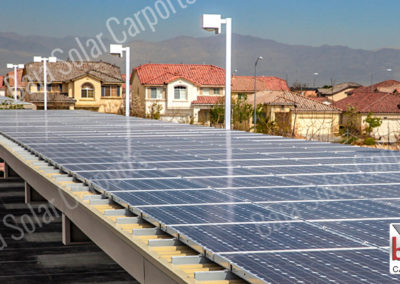 Roof deck with solar panels on top of carport for multi-family tenants