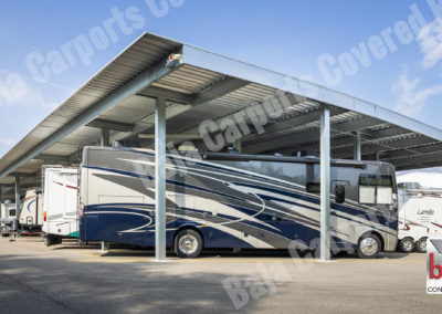 Large RV's are protect from the sun and weather under Carport canopy