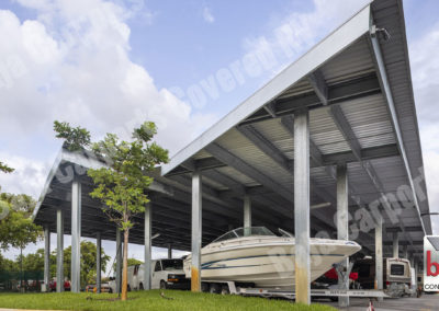 Covered RV & Boat Storage business uses Carports to protect RV's and Boat from weather