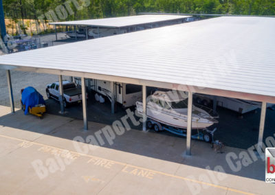 Roof decking on Carport Frame is used as an RV and Boat Storage shade cover