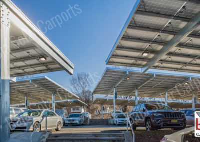 Solar carports on incline parking lot in New Jersey corporate office complex